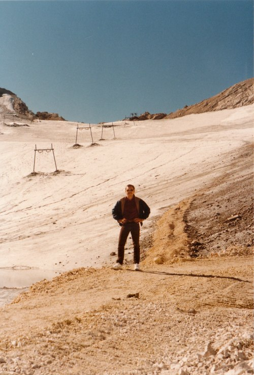 I stand at the edge of the snowfield that may in fact be a glacier by definition, in that it remains year round and never melts completely.
