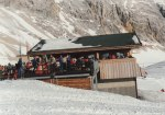 A cozy little cafe on the slopes of the Zugspitze, where you can ski right up to the seating area and order your food and drink.