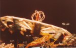 Spinning rides become a blur to both the eye and to the camera lense, as motion outpaces the speed with which each can process the festival of lights before them.