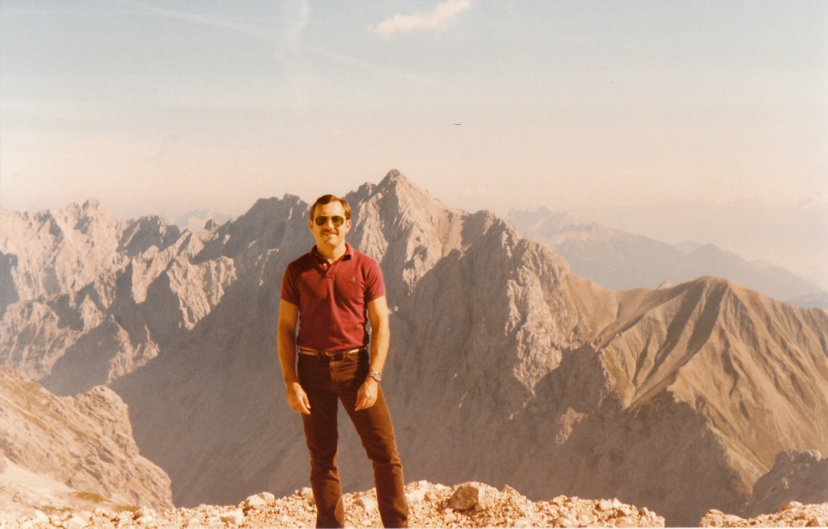 Here I am in a September summertime photograph, instead of my usual wintertime ski portrait in front of the same jagged mountain peak.