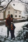 "David and I prepare to have a snowball fight in our front yard during a very snowy December in Monzelfeld - here I rest a snowball on top of David's head for fun - and in later years we would both make ""rabbit ears"" behind each other's head for fun when pictures were taken."