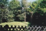 The rustic swingset stands in the side yard that is now completely private - surrounded by the forest that encircled most of the property; everytime we had to move to a new country we always started by downsizing and giving away what we didn't need to pack and take with us.