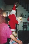 St. Nicholas reviews the year with David's little cousin, who was much too young to really understand what was going on - while David's grandmother helps to explain everything going on to David...as Knecht Ruprecht lingers in the background in the foyer, and is often not even allowed to enter the home as his presence can be too menacing for small children, and as such I omitted posting most of the pictures of him from that evening.