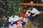 """David and his grandfather or """"Opa"""" explore the gifts that have been placed under the tree - and for a child Christmas is always pure joy and delight."""