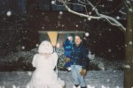 """David and I stand beside our masterpiece, having finished late into the evening as big snowflakes gently float by - with the fresh snowfall adding a smoothing touch to the """"snowwoman"""" standing beside us."""