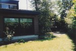 "The back yard behind the living room's sliding glass doors - where David had stood in front of the colorful tulips only a few months ago; and off to the right is the ""hunter's lodge"" style covered porch at the end of the house near David's bedroom."