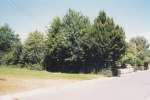 It was now the middle of summer in July 1990, and one Saturday after mowing the yard I took pictures of our entire property - this view is of the empty lot beside the property looking down the long sidewalk in front of our home.