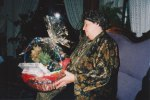 One of David's great-grandmothers looks over a present that she received, fully appreciating the nice basket and festive wrapping.