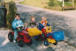 David (right) with his two friends in our driveway with their tractors prior to our moving; and even though David was brought up bilingual in both English and German - being with my wife's family, going to the German Kindergarten and playing with his German friends provided a total immersion in the German language for him.