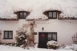 In December 1996, we had a nice snowfall that turned the normally green English countryside into a winter wonderland - this is our good friends' cottage next door to our house at the time.