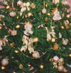 A cropped close-up of our tree that my wife has decorated in pink angels and pink and gold ornaments!