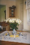 A vase of daises decorates our kitchen table along with a few small Easter touches - our holiday traditions have always been very important to our family - the open doorway leads into the dining room next door.