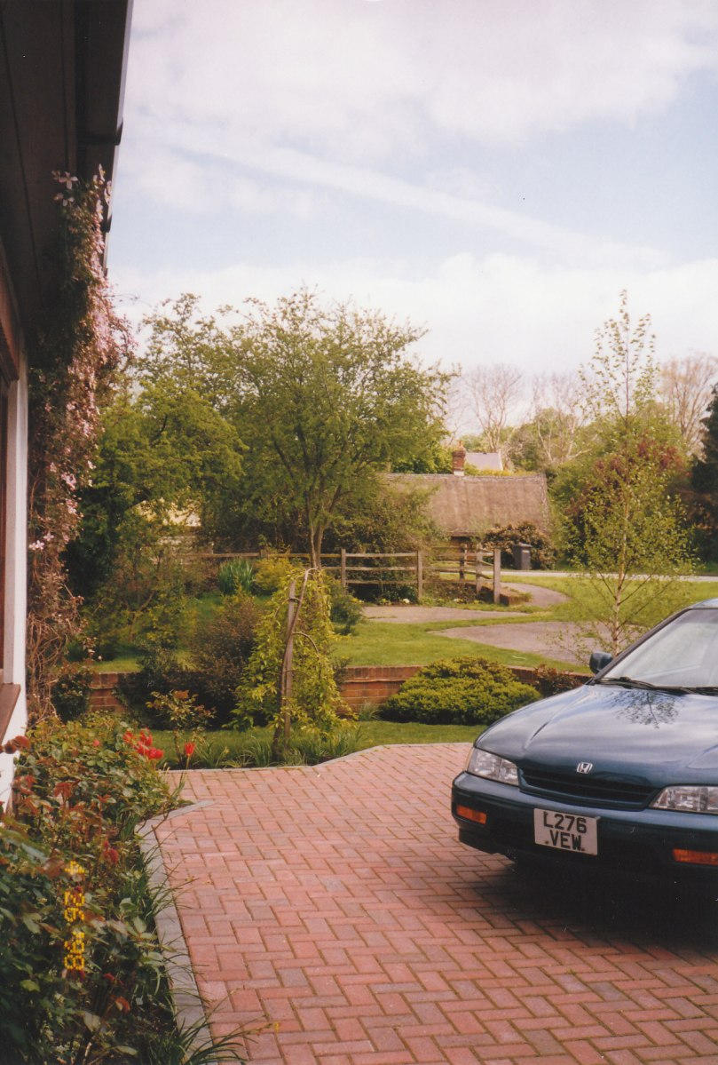 Spring was in full bloom at our home we named Meadow View Cottage in Bridge Street Hamlet - enjoying the Mediterranean, 'micro climate' the bricks in our courtyard created as they warmed up in the sun - just beyond are the remnants of the, 'old road' layby and the historic little, thatched roof Blacksmith's Cottage, just across the A134 Highway.